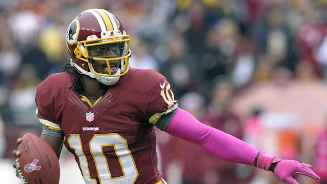 Washington Redskins quarterback Robert Griffin III looks for an open man to throw to during the second half of an NFL football game against the Atlanta Falcons in Landover, Md., Sunday, Oct. 7, 2012. (AP Photo/Susan Walsh)