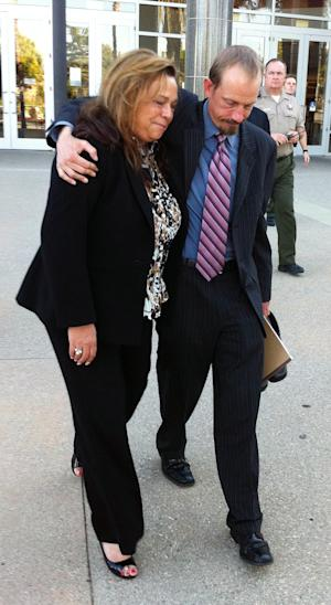 Defense attorney Scott Wippert right, hugs private investigator, Kathryn Lestelle outside court where a mistrial was declared in a gay student murder trial, Thursday Sept. 1, 2011 in Chatsworth, Calif. A judge on Thursday declared a mistrial in the case of California teen, Brandon McInerney, who shot a gay classmate in the back of the head during a computer lab class as stunned classmates looked on. Jurors were unable to reach a unanimous decision on the degree of McInerney's guilt for killing 15-year-old Larry King.(AP Photo/Thomas Watkins)