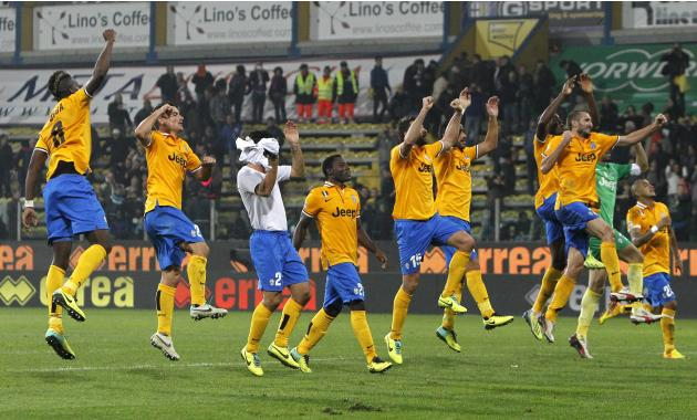 Juventus players celebrate their win at the end of their Italian Serie A soccer match against Parma at Tardini stadium in Parma
