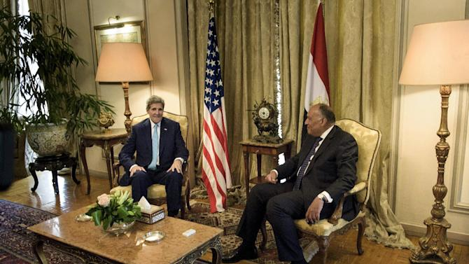 U.S. Secretary of State John Kerry speaks with Egyptian Foreign Minister Sameh Shukri before a meeting at the Ministry of Foreign Affairs in Cairo