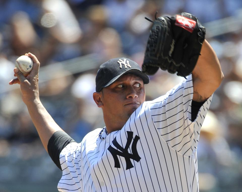 New York Yankees starting pitcher Freddy Garcia throws against the Baltimore Orioles in the first inning of a baseball game on Sunday, July 31, 2011, at Yankee Stadium in New York. (AP Photo/Kathy Kmonicek)