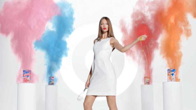 This screen grab provided by Target shows an advertisement from the company featuring a model interacting with baking products.  Target is pushing its food, laundry detergent and other groceries in a national ad campaign that pokes fun at high-fashion advertising by featuring models interacting with everyday products. (AP Photo/Target)