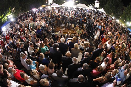 This photo taken with a fisheye lens shows a crowd of people gathered in front of the Centre County Courthouse as Pennsylvania Attorney General Linda Kelly, center, speaks after former Penn State University assistant football coach Jerry Sandusky was found guilty of multiple charges of child sexual abuse in Bellefonte, Pa., Friday, June 22, 2012. Sandusky was convicted of sexually assaulting 10 boys over 15 years, accusations that had sent shock waves through the college campus known as Happy Valley and led to the firing of Penn State's beloved Hall of Fame coach, Joe Paterno. (AP Photo/Gene J. Puskar)