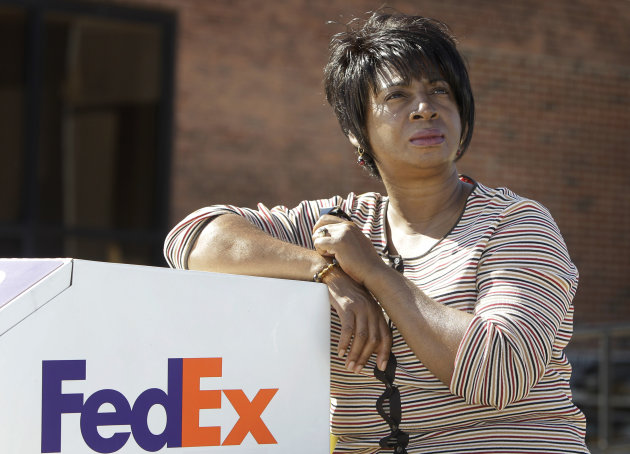 Selena Forte, 55, poses for a photo by a FedEx drop box Saturday, Oct. 8, 2011, in Cleveland. Forte thought she'd found a temporary job at FedEx that met her qualifications but a job recruiter for a temporary agency told her the company wouldn't consider her because she had been out of work too long. She's part of a growing number of unemployed workers who complain they are being screened out of job openings for the very reason they're looking for work in the first place, they're unemployed. (AP Photo/Tony Dejak)