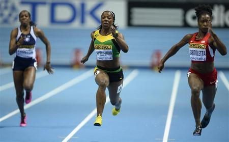 Anguilla's Proctor Jamaica's Campbell-Brown and Bartoletta of the U.S. compete during women's 60m heats at world indoor athletics championships in Sopot
