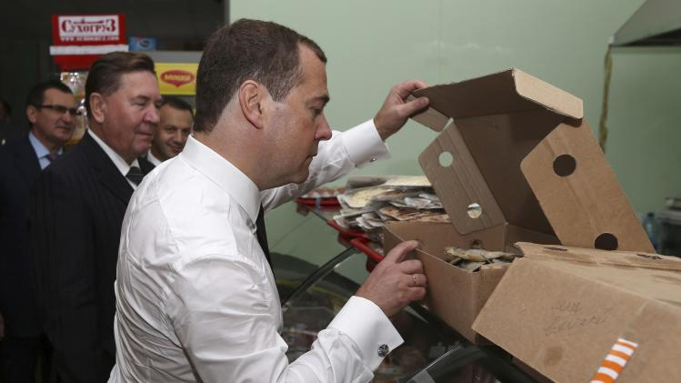 Russia's Prime Minister Dmitry Medvedev visits a grocery store in Kursk region