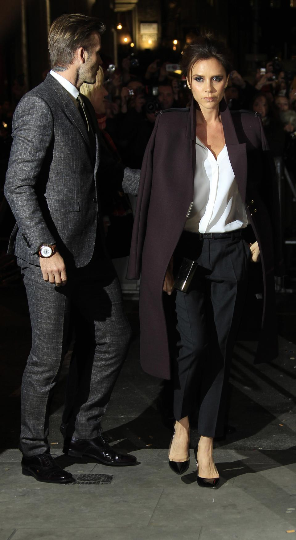 Victoria Beckham, right, and David Beckham arrive for press viewing of Viva Forever!, a musical based on the songs of the Spice Girls, at a theater in central London, Tuesday, Dec. 11, 2012. (Photo by Joel Ryan/Invision/AP)