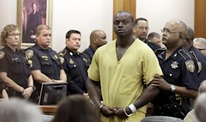 Shannon Miles is escorted out of a courtroom after…