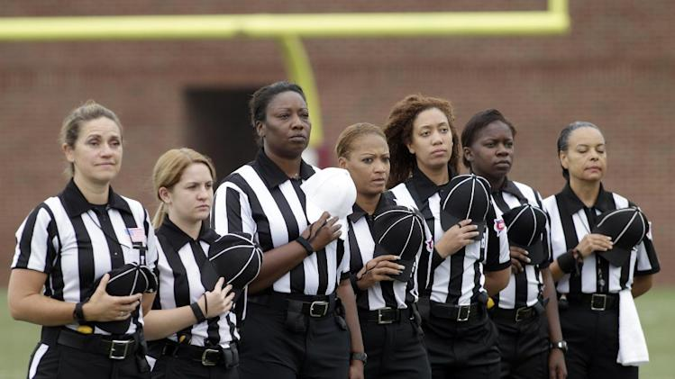 IMAGE DISTRIBUTED FOR NATIONAL FOOTBALL LEAGUE - The women officials line up for the National Anthem at the Legacy Bowl Women's Football Championship, on Friday July 25, 2014 at District Three Stadium in Rock Hill, S.C. The Carolina Queens beat the Minnesota Vixens 28-22. (Bob Leverone/AP Images for National Football League)