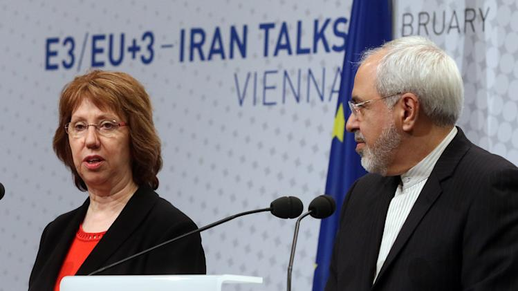European Union High Representative Catherine Ashton, left, and Iranian Foreign Minister Mohammad Javad Zarif, speak to the press after closed-door nuclear talks in Vienna, Austria, Thursday, Feb. 20, 2014. Iran and six world powers are back at the negotiating table eager to come to terms on a comprehensive nuclear deal but deeply divided on what it should look like. The two sides began meeting Tuesday in attempts to build on a first-step accord that temporarily curbs Tehran's nuclear activities in exchange for some sanctions relief. (AP Photo/Ronald Zak)