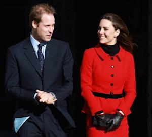 Prince William and Kate Middleton smile as they visit the University of St. Andrews in St Andrews, Scotland on February 25, 2011  -- Getty Images
