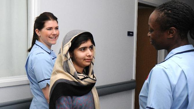 This photo made available by Queen Elizabeth Hospital, Birmingham, England shows Malala Yousufzai saying goodbye as she is discharged from the hospital to continue her rehabilitation at her family's temporary home in the area, Friday, Jan. 4, 2013. the teenage Pakistani girl shot in the head by the Taliban for promoting girls' education has been released from the hospital after impressing doctors with her strength. Queen Elizabeth Hospital Birmingham officials said Friday 15-year-old Malala Yousufzai will be treated as an outpatient before being readmitted for further cranial re-constructive surgery at the end of the month or in early February. (AP Photo/Queen Elizabeth Hospital Birmingham)