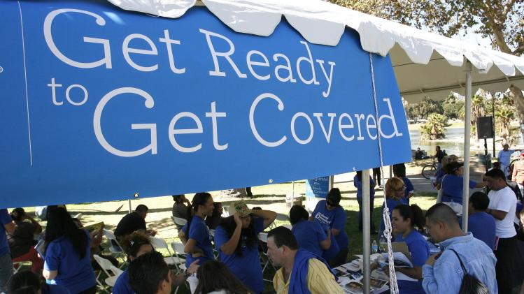 People gather for information during a Planned Parenthood Affordable Care Act outreach event for the Latino community in Los Angeles, California