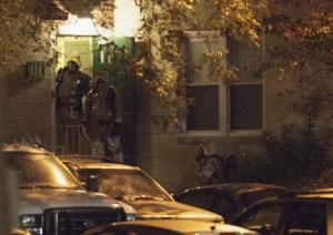Authorities enter an apartment building in Stamford