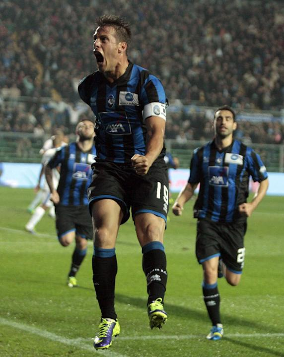 Atalanta's German Denis, of Argentina, celebrates after scoring during a Serie A soccer match against Inter Milan in Bergamo, Italy, Tuesday, Oct. 29, 2013