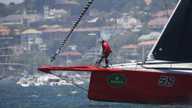 A crewman aboard Comanche stands at the bow of the yacht before the start of the Sydney to Hobart Yacht Race
