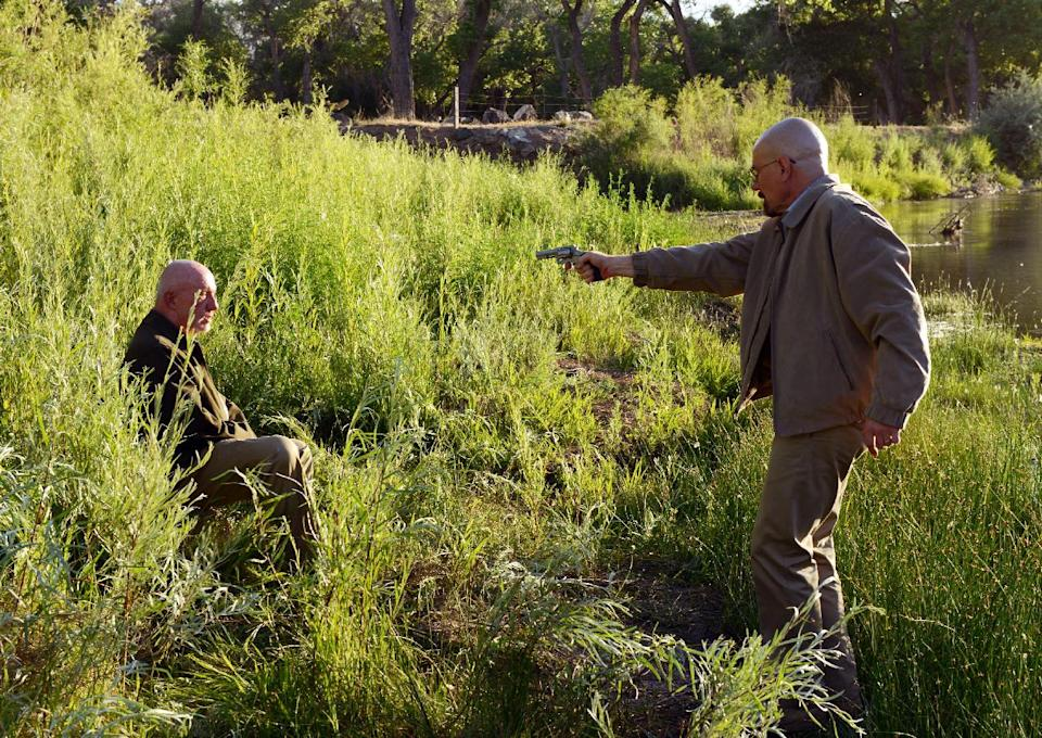 "This Image released by AMC shows Walter White played by Bryan Cranston, right, pointing a gun at Mike Ehrmantraut, played by Jonathan Banks in a scene from the fifth season of ""Breaking Bad."" The series finale of the popular drama series airs on Sunday, Sept. 29. (AP Photo/AMC, Ursula Coyote)"