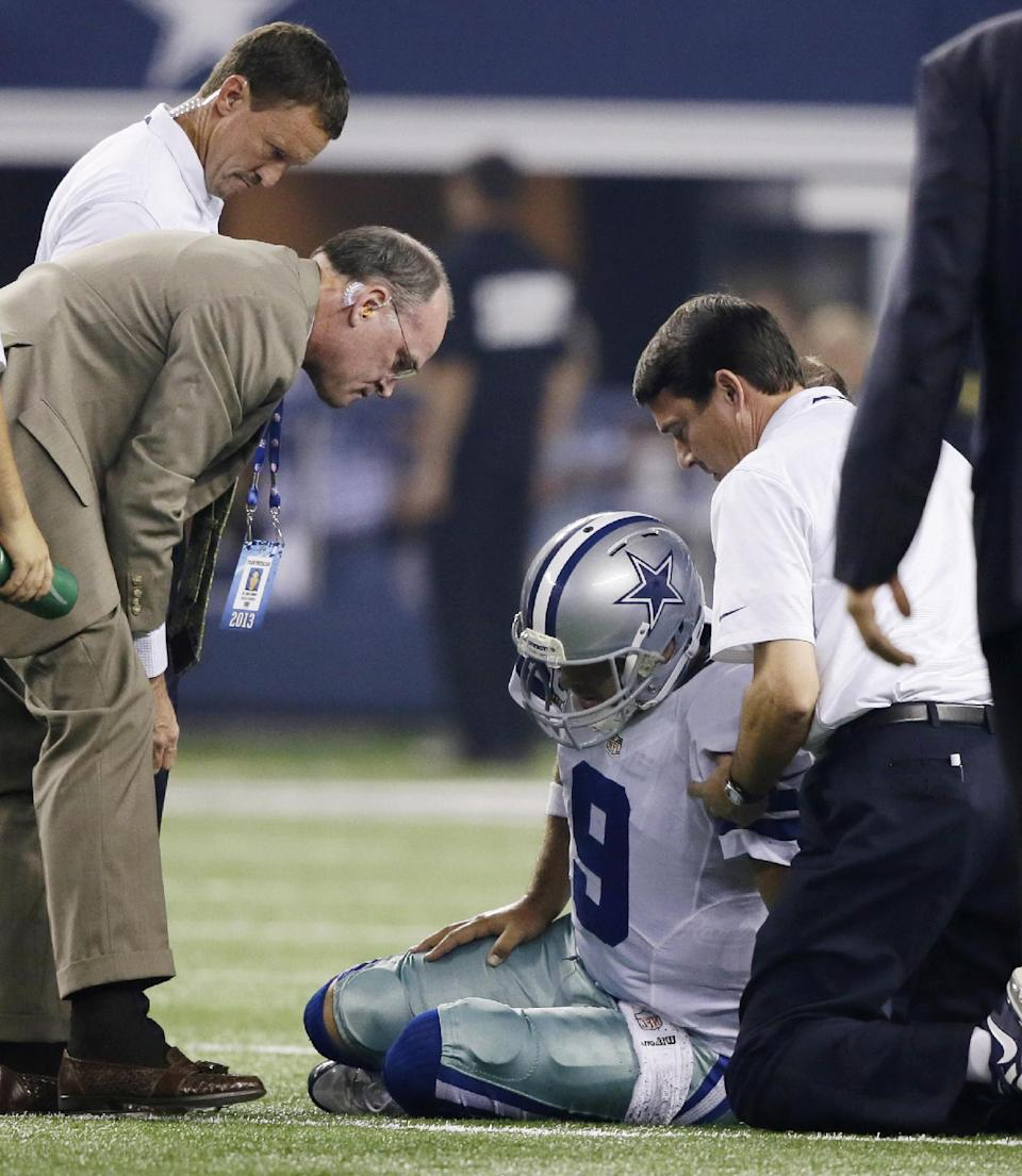 Romo will play on as X-rays show no damage to ribs