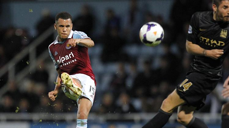 West Ham United's English midfielder Ravel Morrison (L) has a shot at goal during his side's English Premier League match Manchester City at Upton Park in London, on October 19, 2013