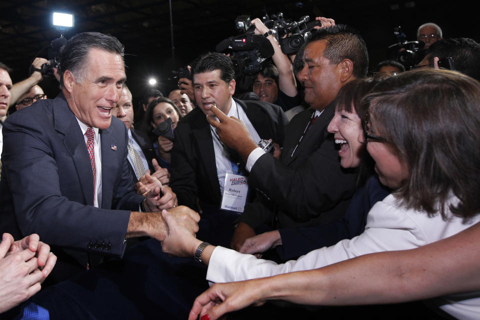 Republican presidential candidate, former Massachusetts Gov. Mitt Romney, greets attendees at the NALEO (National Association of Latino Elected and Appointed Officials) conference in Orlando, Fla., Thursday, June 21, 2012. (AP Photo/Charles Dharapak)