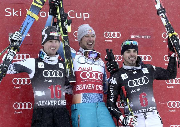 Medallists Aksel Lund Svindal, Hannes Reichelt and Peter Fill celebrate on the podium after the men's World Cup downhill in Beaver Creek