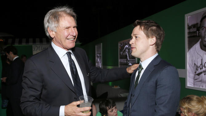 "Harrison Ford and T.R Knight attend the after party for the LA premiere of ""42"" at the TCL Chinese Theater on Tuesday, April 9, 2013 in Los Angeles. (Photo by Todd Williamson /Invision/AP)"