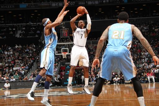 Johnson and Nets beat Nuggets 119-108