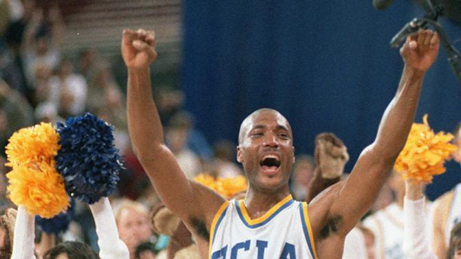 FILE - In this April 3, 1995 photo, UCLA's Ed O'Bannon celebrates after his team won the championship NCAA game against Arkansas in Seattle. A federal judge has ruled that the NCAA can't stop college football and basketball players from selling the rights to their names and likenesses, opening the way to athletes getting payouts once their college careers are over, Friday, Aug. 8, 2014. (AP Photo/Eric Draper, File)