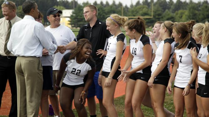 A girl on the Galesburg High School volleyball team reacts as she gets to meet President Barack Obama as he visits the school, Wednesday, Aug. 17, 2011, in Galesburg, Ill., during his three-day economic bus tour.  (AP Photo/Carolyn Kaster)