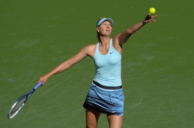 Maria Sharapova, of Russia, serves to Camila Giorgi, of Italy, during a third round match at the BNP Paribas Open tennis tournament, Monday, March 10, 2014 in Indian Wells, Calif