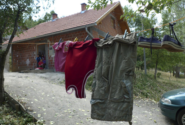 In this Saturday Aug. 11, 2012 photo the clothes in which 6-year-old Tarik Bijelic died hang on the line in front of his family&#39;s small house in the village of Olovske Luke, 60 kilometers north of Sarajevo, Bosnia. Tarik Bijelic was hit by a land mine last week as he scavenged in the forest for firewood to help his family make ends meet. He died in his fathers arms. Under an international treaty, Bosnia was supposed to be free of mines by 2009. Instead, it has quietly obtained another decade to clear the estimated 1,300 remaining square kilometers (500 square miles) of mine fields. In the 16 years since Bosnia&#39;s three-year war ended, mines have killed 591 people. So far this year, seven people have been killed and 3 maimed. (AP Photo/Amel Emric)