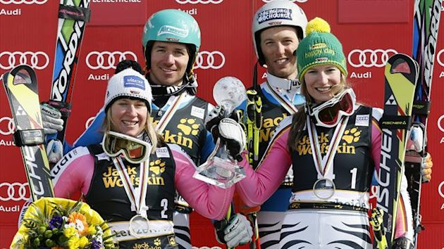 Germany's team members (L to R) Veronique Hronek, Felix Neureuther, Lena Duerr and Fritz Dopfer celebrate after placing first in the national team event following the season's last race at the Alpine Skiing World Cup finals in Lenzerheide