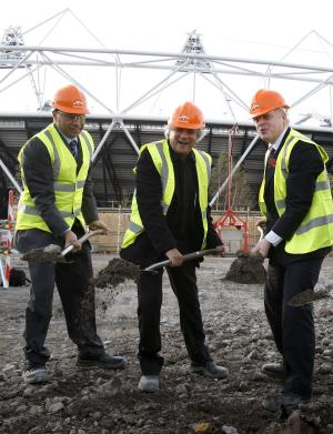 Lakshmi Mittal,  Chairman of Arcelor Mittal ,left, Anish Kapoor, artist, centre,  Boris Johnson, Mayor of London, right, during a ceremony to start construction of the ArcelorMittal Orbit at the Olympic Park in London, Thursday, Nov. 4, 2010.  The Orbit will be Britain's tallest sculpture standing at 114metres. (AP Photo/Kirsty Wigglesworth)