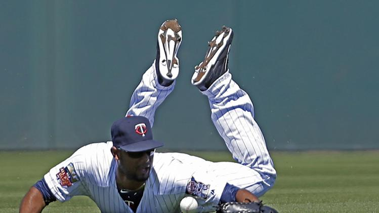 Minnesota Twins center fielder Aaron Hicks (32) dives for a single hit by Boston Red Sox Mike Napoli in the second inning of an exhibition baseball game in Fort Myers, Fla., Thursday, March 13, 2014