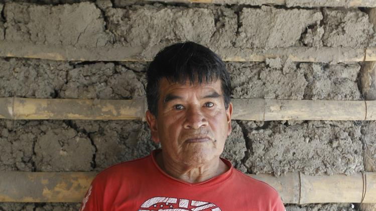 Manuel Bonilla, 62, who lost his right arm when rebels detonated a bus bomb in Toribio's central square, poses in his house during a Reuters interview in Toribio