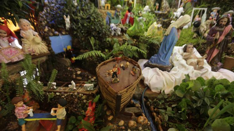 Miniature replica of Noah's Ark is seen in this nativity scene sculpture display prepared by the Sabate family in Luque