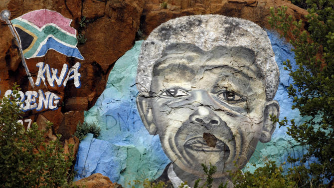 "A mural depicts South African President Nelson Mandela on a hill in Soweto, South Africa, Wednesday, Dec. 12, 2012. South Africa's former President Nelson Mandela ""has made progress"" in getting better after contracting a lung infection, officials said Wednesday. A short statement issued by current President Jacob Zuma's office announced Mandela's status, as the 94-year-old leader's stay in a military hospital near South Africa's capital, Pretoria, stretched into a fifth day Wednesday. (AP Photo/Themba Hadebe)"