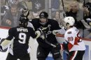 Pittsburgh Penguins&#039; Sidney Crosby (87) celebrates scoring his second goal of the first period with teammate Pascal Dupuis (9) as Ottawa Senators&#039; Cory Conacher (89) skates back to his bench during Game 2 of an NHL hockey Stanley Cup second-round playoff series, in Pittsburgh on Friday, May 17, 2013.(AP Photo/Gene J. Puskar)