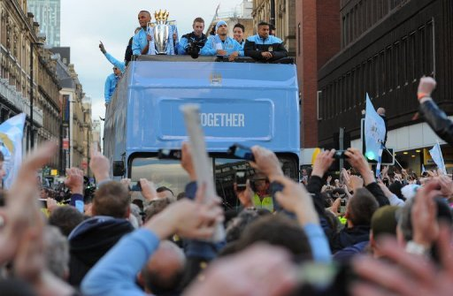 Manchester city celebrate becoming Premier League champions in May