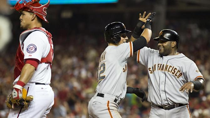 Nationals' 10-game win streak ends, Giants romp