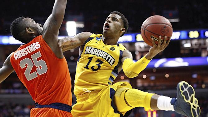 Marquette guard Trent Lockett (13) shoots past Syracuse forward Rakeem Christmas (25) during the second half of the East Regional final in the NCAA men's college basketball tournament, Saturday, March 30, 2013, in Washington. (AP Photo/Mark Tenally)