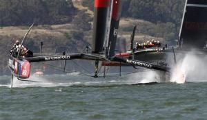 Emirates Team New Zealand gets to the first mark ahead of Oracle Team USA during Race 7 of the 34th America's Cup yacht sailing race in San Francisco