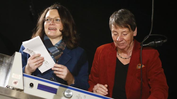 "SPD Secretary General Nahles and fellow party member Hendricks operate an automatic high speed letter opener to count the ballots of the ""Member Vote"" for a new ""grand coalition"" between the SPD and the CDU, in Berlin,"