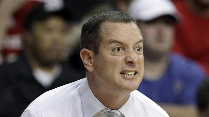 FILE - In this Jan. 7, 2012, file photo, Rutgers coach Mike Rice reacts to play during an NCAA college basketball game against Connecticut in Piscataway, N.J. The airing Tuesday, April 2, 2013, of a videotape of Rice using gay slurs, shoving and grabbing his players and throwing balls at them in practice over the past three seasons has Rutgers athletic director Tim Pernetti reconsidering his decision not to fire the coach. Pernetti was given a copy of the video in late November by a disgruntled former employee, and he suspended Rice for three games, fined him $50,000 and made him undergo anger management classes for inappropriate behavior after investigating it. (AP Photo/Mel Evans, File)