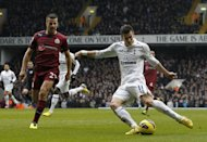 Tottenham winger Gareth Bale (R) scores his second goal in the 2-1 home win over Newcastle United at White Hart Lane on February 9, 2013. Bale maintained his sublime form with a brilliant brace against a stubborn Newcastle