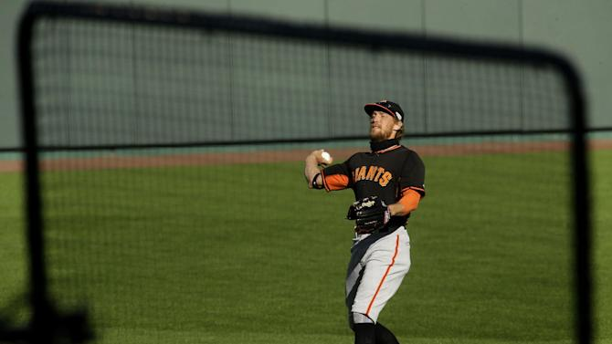 San Francisco Giants' Hunter Pence throws during baseball practice Monday, Oct. 20, 2014, in Kansas City, Mo. The Kansas City Royals will host the Giants in Game 1 of the World Series on Oct. 21. (AP Photo/Charlie Riedel)