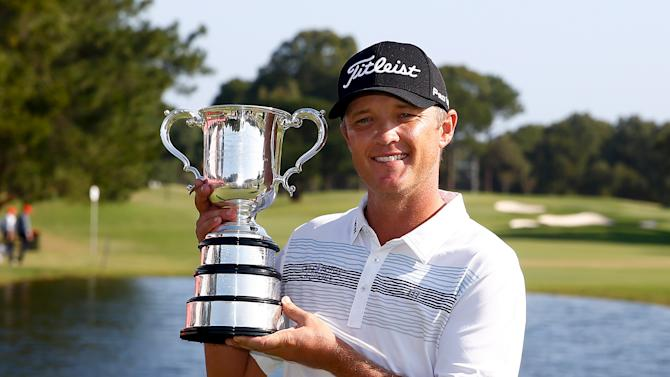 Australia's Jones poses with the 2015 Australian Open golf trophy in Sydney, Australia
