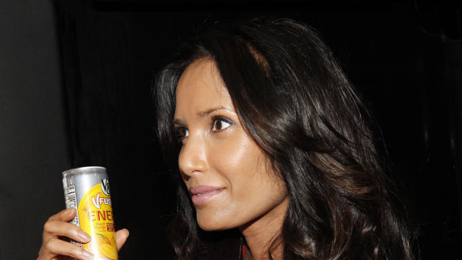 """IMAGE DISTRIBUTED FOR V8 - Padma Lakshmi takes advantage of the V8 V-Fusion + Energy 24th Hour Mega Bus on Friday, March 8, 2013 in New York City. Naturally powered by ingredients like green tea, vegetables and fruit, V8 V-Fusion + Energy is helping Americans """"Spring Forward"""" this weekend when they've lost an hour of sleep. (Amy Sussman / AP Images for V8)"""