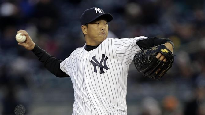 New York Yankees starting pitcher Hiroki Kuroda winds up in the first inning of a baseball game against the Boston Red Sox at Yankee Stadium in New York, Wednesday, April 3, 2013. (AP Photo/Kathy Willens)