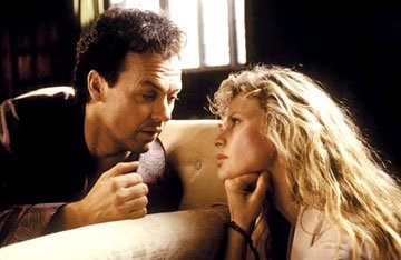 Michael Keaton as Bruce Wayne and Kim Basinger as Vicki Vale in Warner Bros. Pictures' Batman